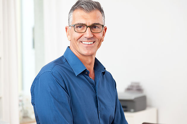 Image of a man in Tips for running your business on a tight budget article